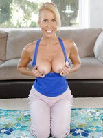 Horny Erica Lauren fucks herself with a magic wand after finishing her regular morning exercise