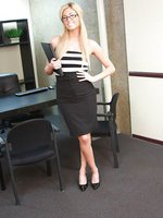 Busty blonde secretary Victoria White strips at the office