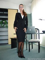 Secretary Claudia in black nylons strips