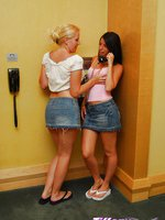 Naughty girls at the phone booth