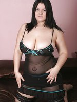 Kim B strips to reveal her big 34GG juggs