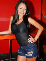 Christina has on tight denim shorts that she slips down and fingers herself