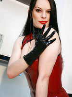 Strict Domina masturbates in latex