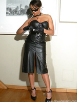 Hot ebony girl smokes in leather