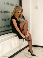 Hot leggy blonde Kathryn buckles up her high heels in sexy nylon stockings and a beautiful long black dress