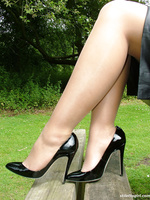 Hot blonde Milf Jess shows her shiny black heels and stockings in her cheeky short office skirt