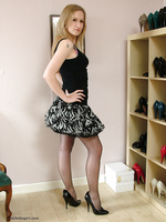 Cute blonde Iona is at home getting turned on by trying on her vast collection of sexy high heels