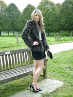 Sexy Kim posing outdoors in a fur coat and some sexy high heels