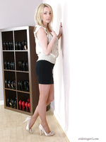 White stiletto heels and a very tight mini skirt is always a treat