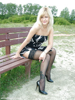 This gorgeous blonde has some lacy stockings under her tiny dress