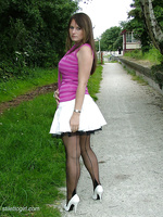 Outdoors in white stiletto heels