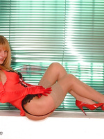 Blonde in grey lacy stockings & red patent heels