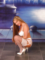 Busty blonde in sheer white lingerie & stockings with white heels