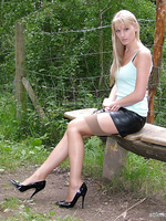 Stunning blonde Alexis outside in stockings and black patent stilettos