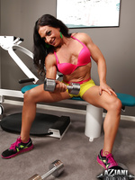 A sexy set of Ripped Vixen working out in the gym pumping up her sexy muscles.