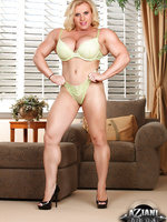Joanna Thomas loves to dress up in sexy lingerie and show off her strong and powerful body.