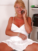 Blonde and Tanned Sylvie relaxes on top of her plastic toy