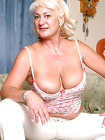 MILF with big plump boobs speads her mature pussy for us