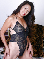 Exotic MILF in black lingerie peels and spreads her asian pussy