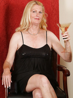 Elegant 55 year old enjoys a bit of wine and then herself in here