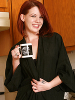 31 year old and redheaded Lilla Katt fooling around naked in the kitchen