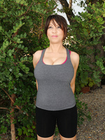 Horny 50 year old Lola from AllOver30 stretches and strips outdoors