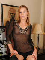 Blonde housewife Alyssa Dutch posing in and out of her black lingerie