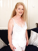 62 year old GILF Nelli from AllOver30 slides out of her white lingerie