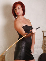 Sexy femdom Honey whips her cane against her leather boots, warming up for your naughty bottom
