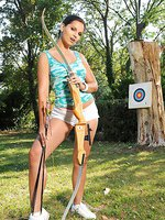 Eve Angel naked barefoot archery