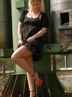 Outsite in black skirt and suntan pantyhose