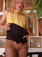 Angel in suntan sheer over black crotchless pantyhose