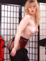 Angel as film diva in red genuine stockings ober black ph