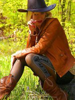 Sexy cowboy babe outdoor in pantyhose