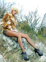 Leggy mom in black pantyhose spreads hot legs in the nature