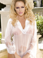 What could be better than seeing stunning busty blonde, Dyanna Lauren, wearing nothing but a wet see thru shirt.  Not much at all!