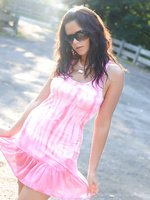 Ann Angel in pink summer dress and pink panties gets totally naked in public!