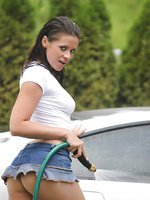 Ann Angel nude carwash covered in soap suds wearing a short miniskirt