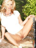 Rachel Aziani loves having some fun posing on the waterfall in her white dress. It was so hot outside that she thought getting wet would be a good way to cool off her pussy.