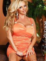 Busty blonde, Rachel Aziani, loves how her tits looks in her sexy dress. But she loves stripping it off even more showing off her goodies, especially her hard clit.