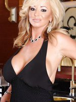 Gorgeous blonde babe, Rachel Aziani, is dressed up in her sexy black dress that shows off her big boobs, and gets so turned on she's got to strip down to nothing!