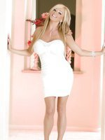 Rachel Aziani looks amazingly hot in her tight, form-fitting white dress that shows off her amazing big tits and body!  She looks even better stripping out of it to nothing but her heels!