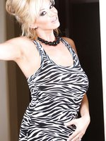 Rachel Aziani looks stunning stripping out her tight, zebra-print dress!