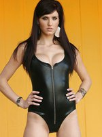 Black latex clings to Autumn, but she manages to get her one piece off for us!