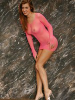 Wanna know more about Jess? Take a look at her pink fishnet dress and you will get up close and personal!