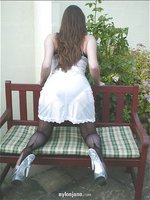 Jane outdoors on bench in white negligee looking hot