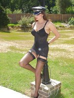 Jane poses outside in lingerie and stockings