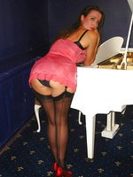 Jane bends over a piano and shows her hot ass