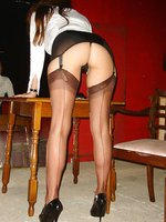 Hot secretary strips and flashes in warehouse