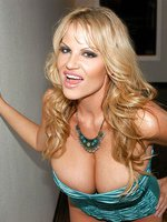 Kelly in turquoise lingerie gets horny in the hallway and uses a turquoise dildo.